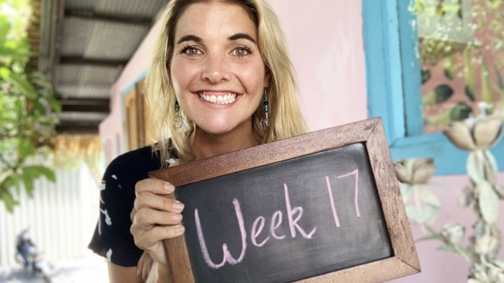 """Abbey holding a chalkboard that says, """"week 17"""""""