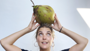Abbey holding a coconut on top of her head